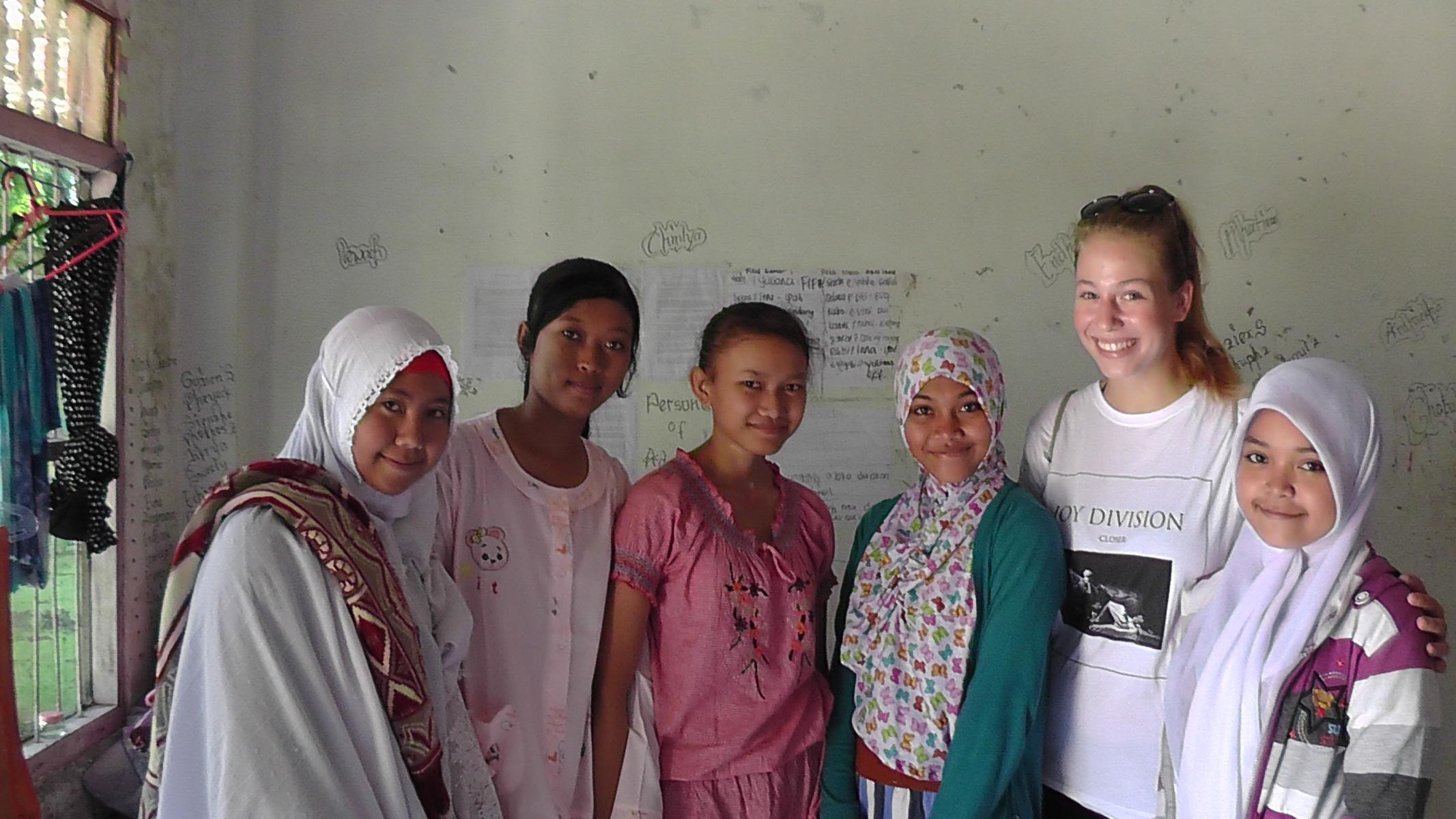 Volunteer with girls from the orphange